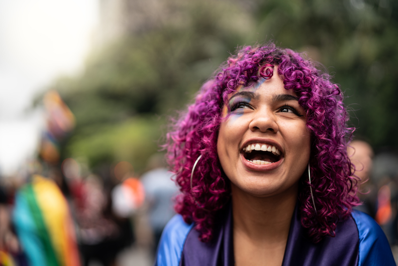 excited young person with pink hair