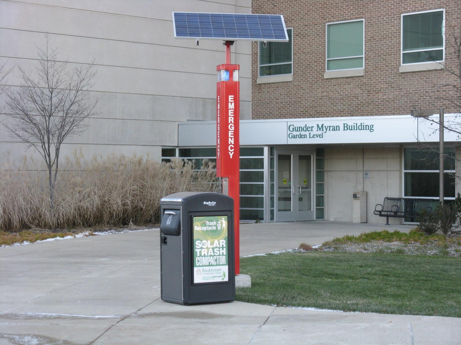 Solar powered emergency phone and trash compactor
