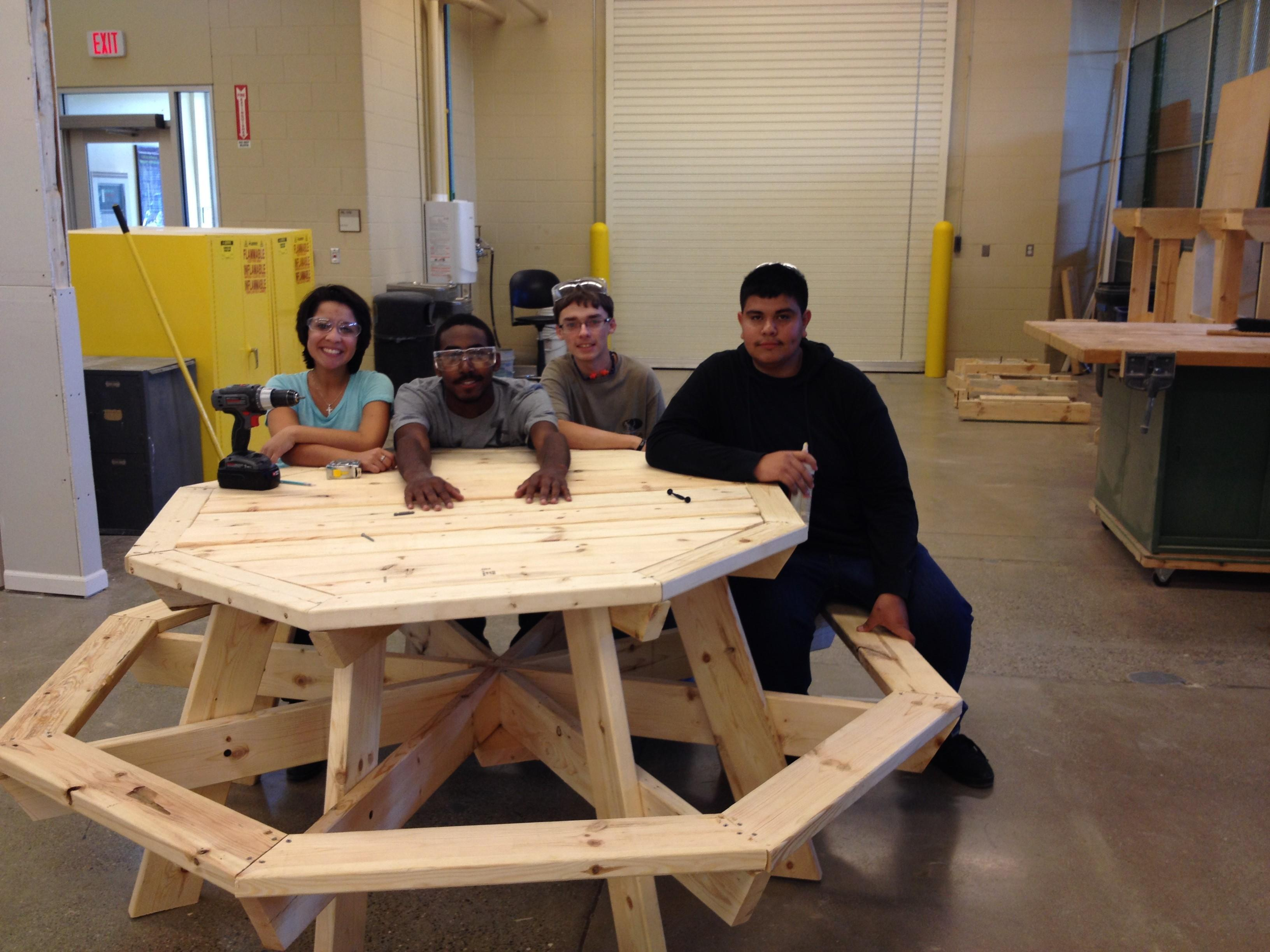 Construction students build a picnic table for local non-profit Growing Hope