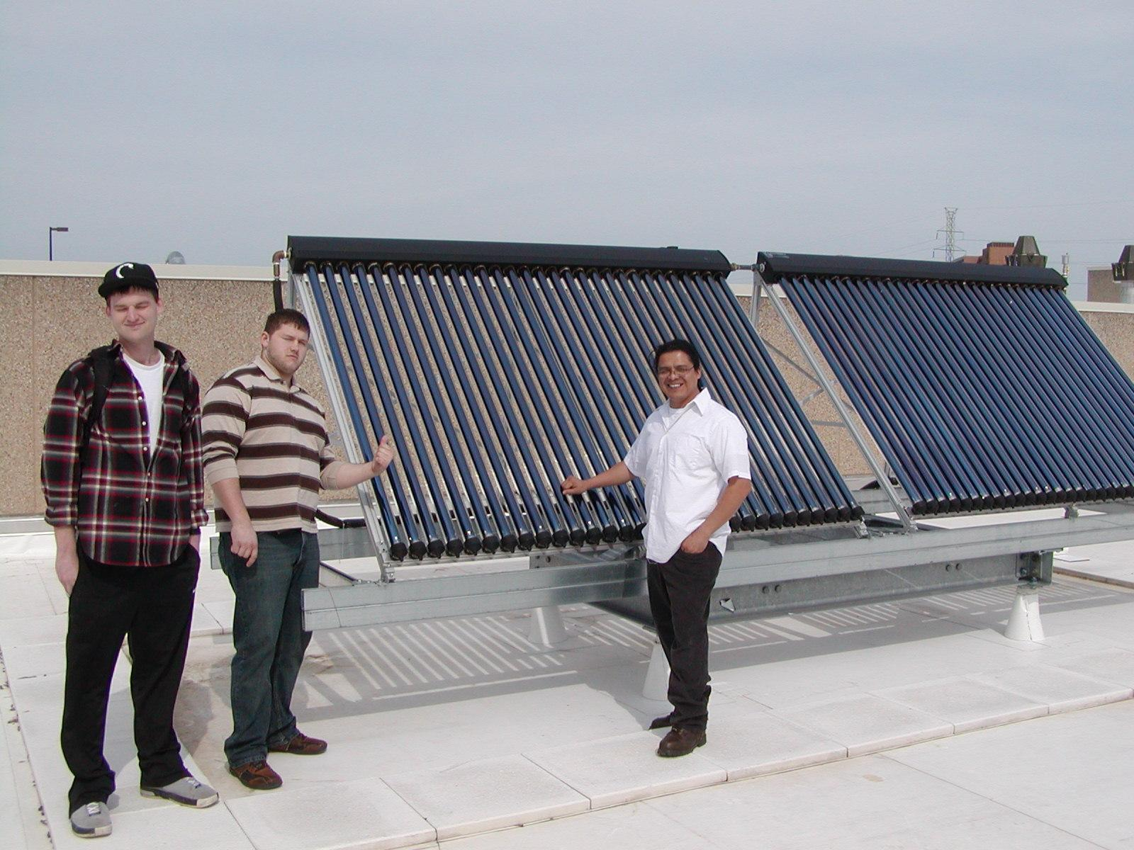 Students with solar hot water panels.