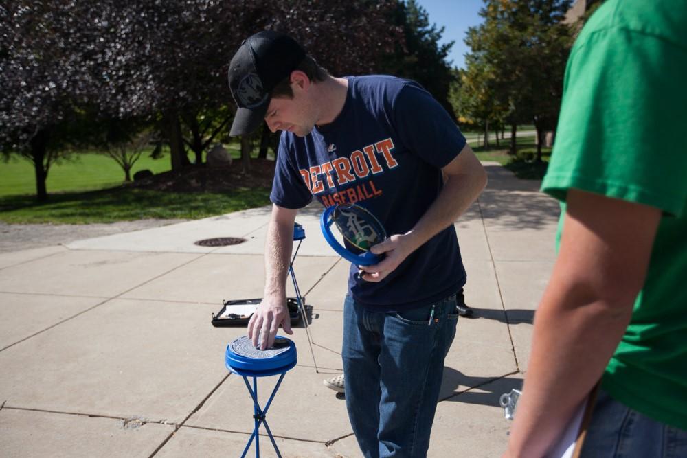 Renewable Energy student sets up Solar Pathfinder instrument