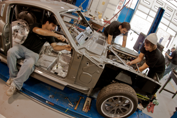 automotive students working on a car
