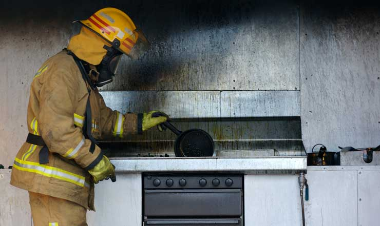 fire investigator looking at charred stove
