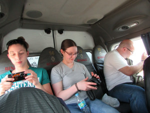 During the ride to Ilo, WCC students check their pictures and snap a few more out the van's windows.