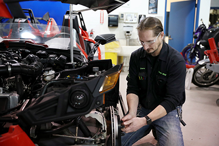 Shawn Deron, an instructor in WCC's Motorcycle Service Technology department, puts the finishing touches on the vehicle the college is displaying in the Automobili-D exhibition at NAIAS on Jan. 14-17. Deron led the multi-department project.