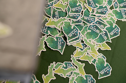 A stack of stickers was among the giveaways at a previous Welcome Day.