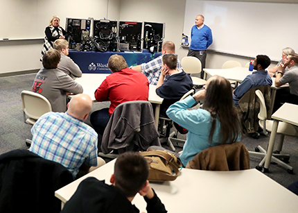 High school students listen to WCC faculty Cyndi Millns and Michael Galea discuss the importance of cybersecurity Nov. 12 at Square One's Autonomous Innovative Vehicle Design program, which kicked off earlier in the day.