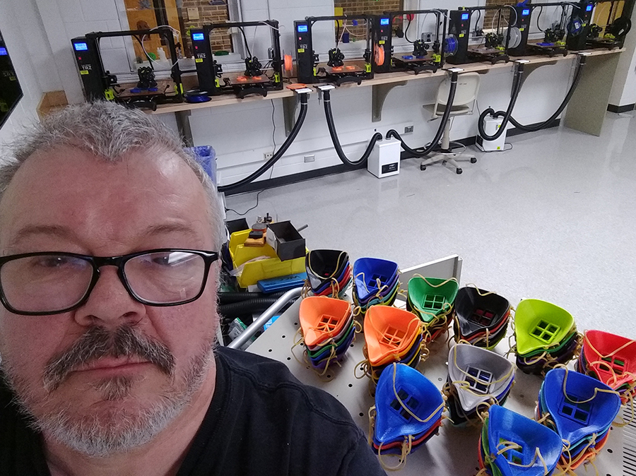 Tom Penird in front of 3D printed masks
