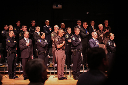 The WCC Police Academy Class of 2019 recites the Pledge of Allegiance before Friday's graduation ceremony.