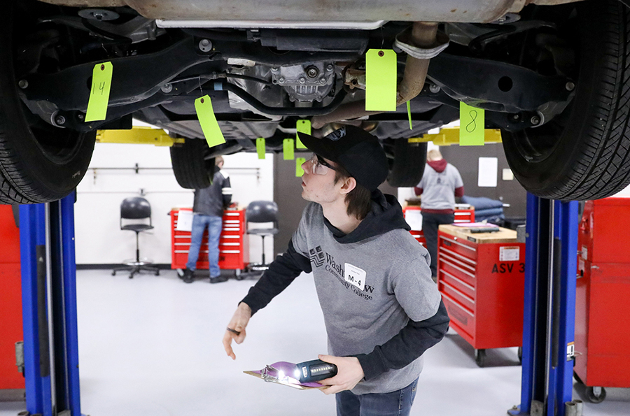 Liam Stanyer of Lake Orion High School works underneath a vehicle during a Skills USA competition at WCC.