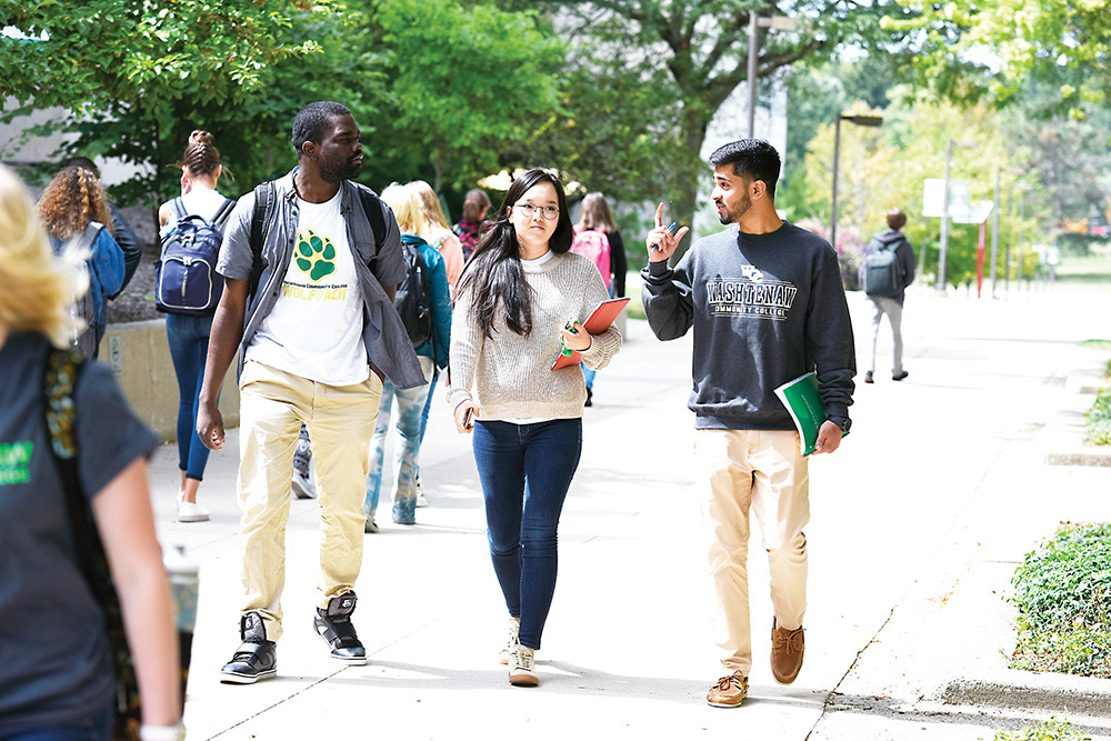 Students (from left) Paul Katokwe, Undraa Bayasgalan and Shahzar Mirza walk across a busy WCC campus during the first week of the Fall 2017 semester. | Photo by Lon Horwedel