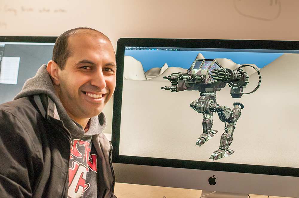 3-D Animation student Moh Kahla shows off one of his creations. | Photo by Jessica Bibbee