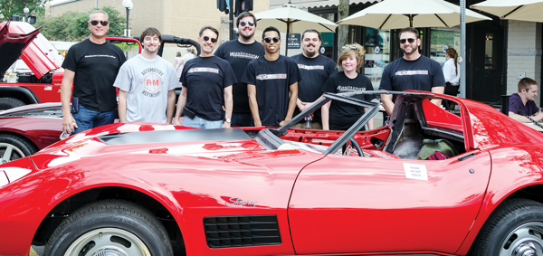 Washtenaw Community College Auto Body Repair Program instructor and advisor Scott Malnar (far left) poses alongside a 1971 Stingray Corvette with students (from left to right) Steven Salah, Tom Holevinski, Jason Bazylewicz, Trey Trotter, Liam Clark, Aideen Quinn and Jason Mosquera.
