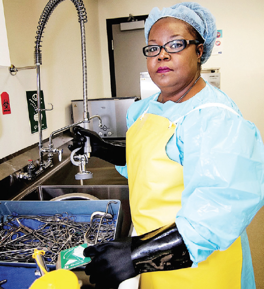 LaChanda Thomas working in a Sterile Processing lab.