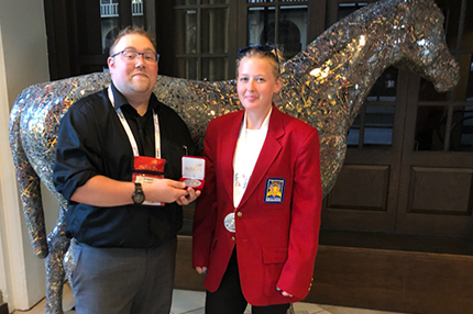 WCC student Ashlea Carravallah (right) poses with instructor Bobby Feldkamp and her SkillsUSA silver medal.