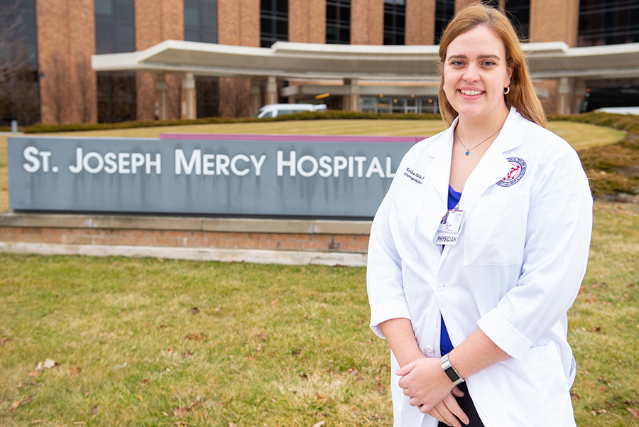 Dr. Erika Gale next to a St. Joseph Mercy Hospital sign