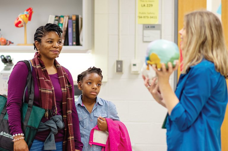 "Gwen Hooks and her daughter, Jocelyn, of Belleville, observe Washtenaw Community College faculty member Susan Dentel during her Free College Day class, ""Behind the Scenes: A Backstage Pass to the STEM Labs."" (Photo by CJ South)"