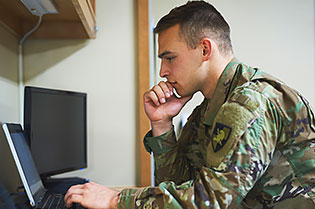 military student at computer